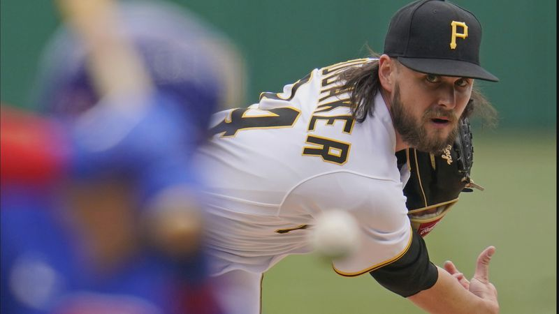 Pittsburgh Pirates starting pitcher JT Brubaker delivers during the first inning of a baseball...