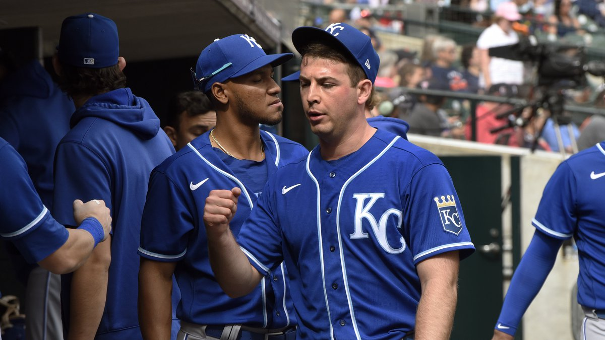 Kansas City Royals starting pitcher Kris Bubic, foreground, is congratulated in the dugout...