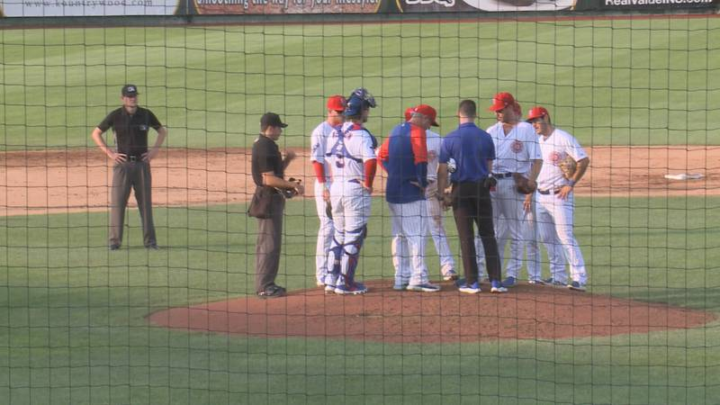 South Bend Cubs meet on the mound during a game against the Cedar Rapids Kernels on July 13,...