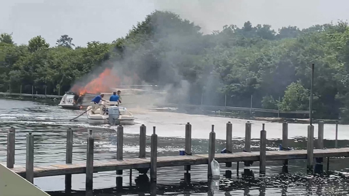 A boat catches on fire on Lake Wawasee Saturday.