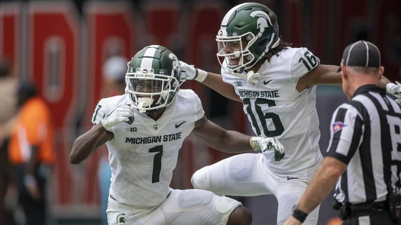 Michigan State wide receiver Jayden Reed (1) celebrates scoring a touchdown against Miami with...