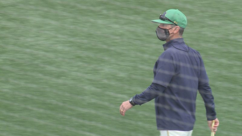 Irish manager Link Jarrett walks to dugout before a game with NC State on April 17, 2021.