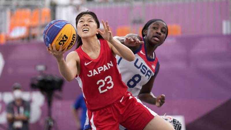 Japan's Mai Yamamoto (23) shoots as United States' Jacquelyn Young (8) defends during a women's...