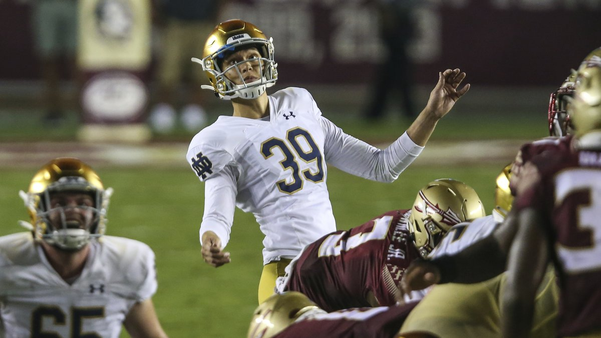 Notre Dame place kicker Jonathan Doerer (39) watches his successful field goal clear the goal...