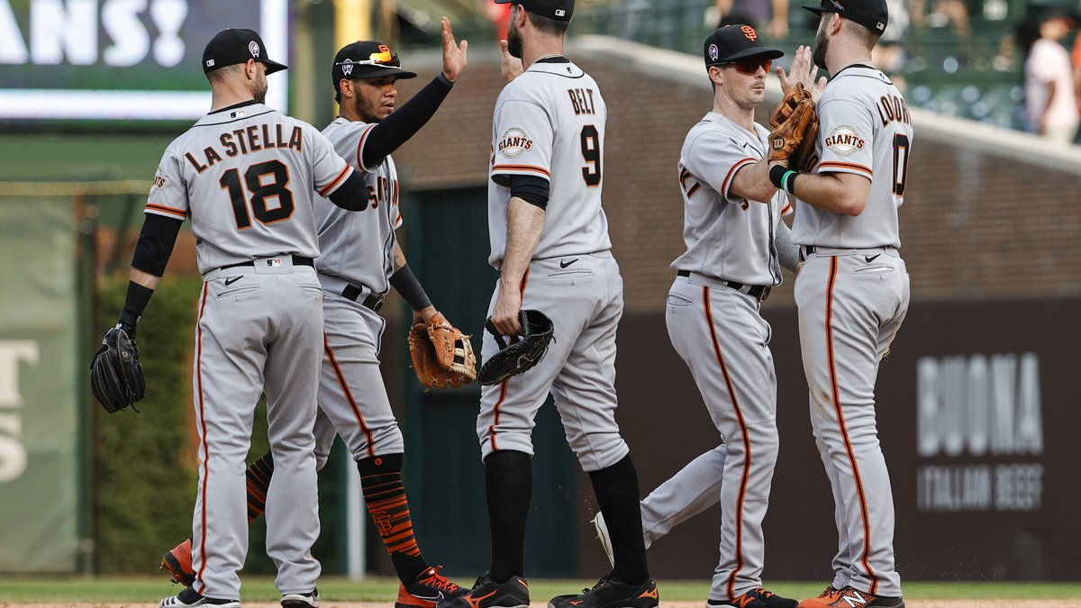 San Francisco Giants players celebrate the team's 15-4 win over the Chicago Cubs in a baseball...