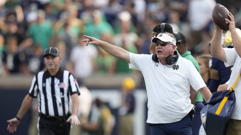 Notre Dame head coach Brian Kelly gestures from the sideline during the second half of an NCAA...
