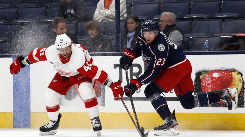 Columbus Blue Jackets forward Stefan Matteau, right, passes in front of Detroit Red Wings...