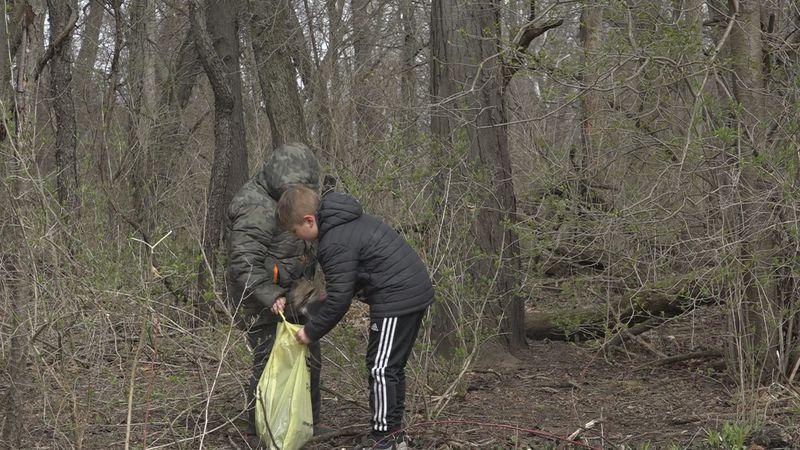 Two local boys clean up Baugo Creek