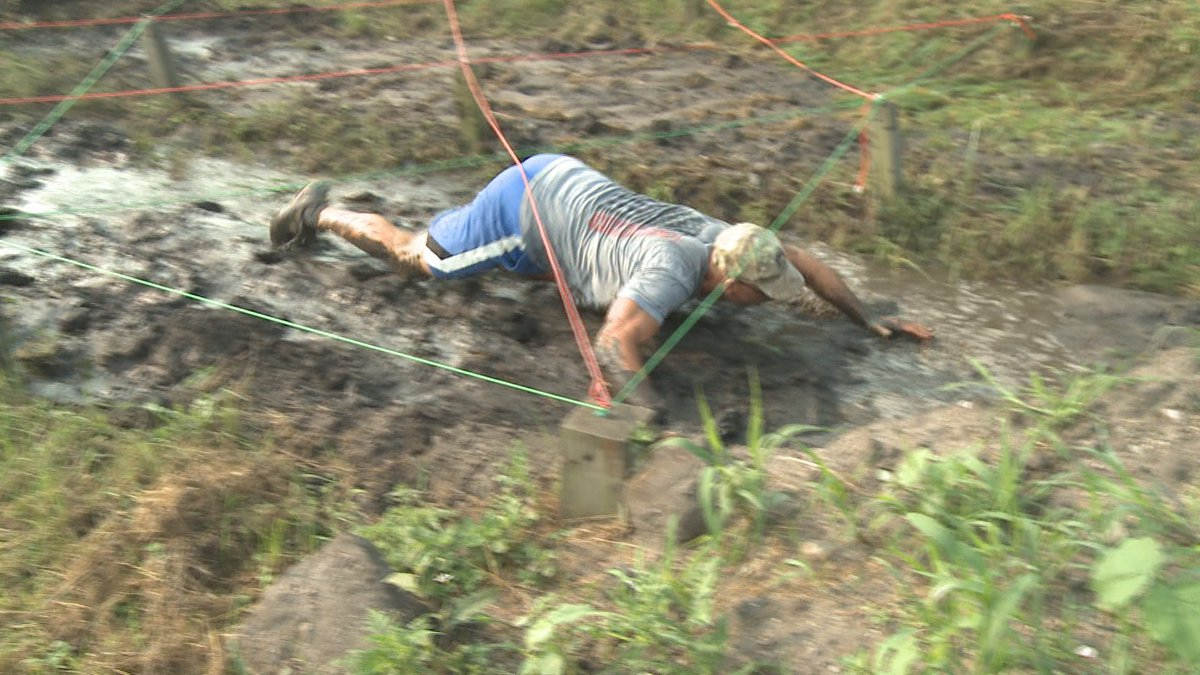 Dozens of other participants trekked the five-kilometer course that includes ten obstacles and...