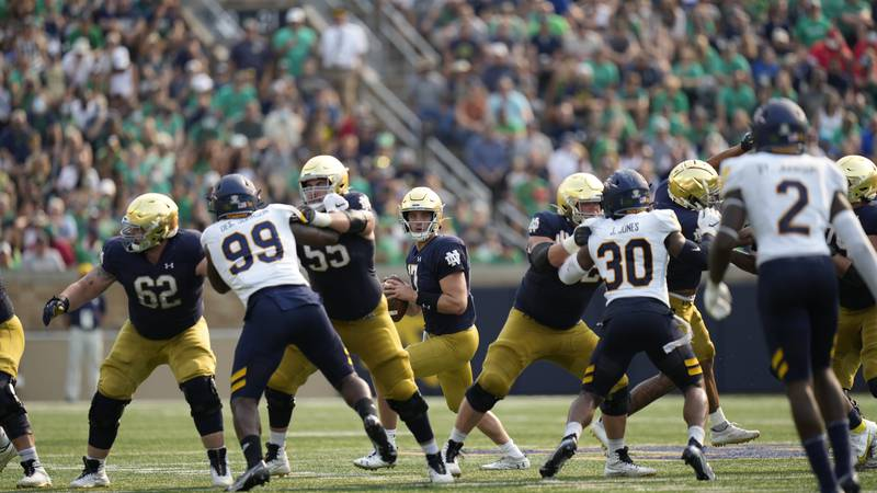 Notre Dame quarterback Jack Coan (17) in action against Toledo in an NCAA college football game...