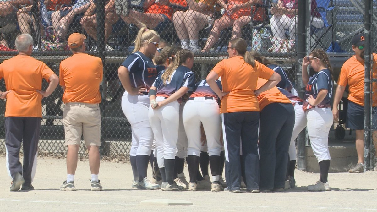 The Bridgman softball team huddles up before the state quarterfinal match up with Whiteford on...