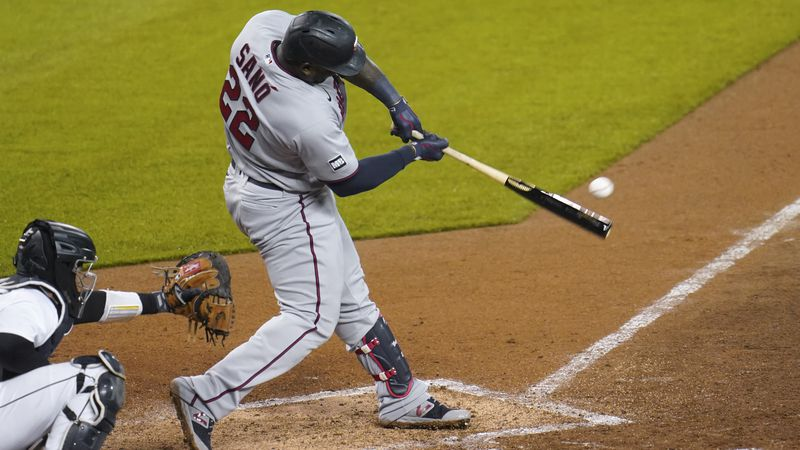 Minnesota Twins' Miguel Sano (22) hits a one-run single against the Detroit Tigers in the ninth...
