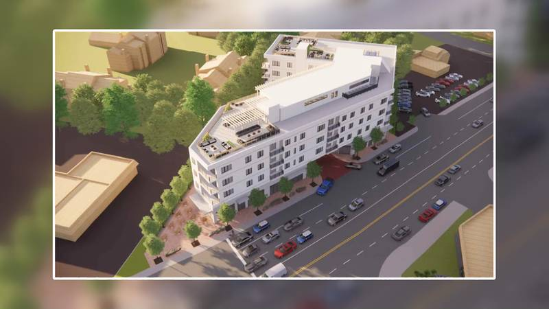 Three floors of the building would house 27 residential units that would be marketed to Notre...