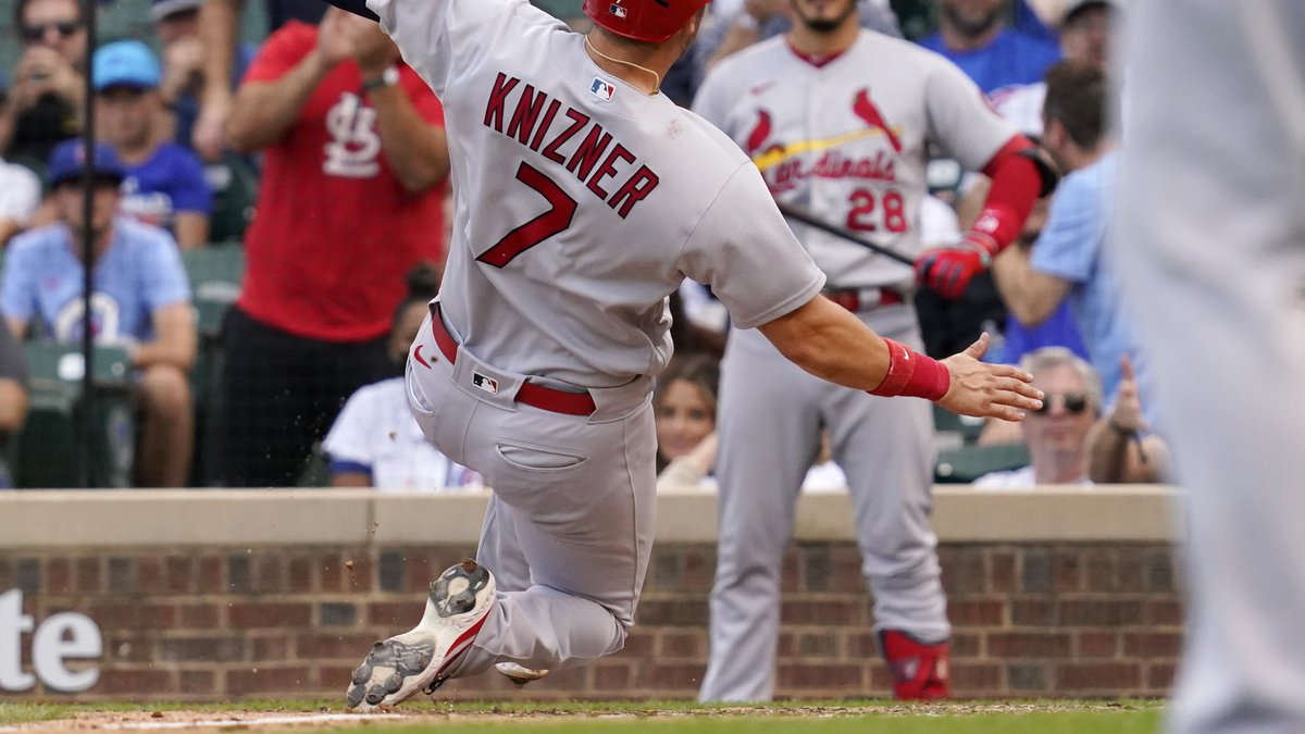 St. Louis Cardinals' Andrew Knizner (7) scores on a wild pitch from Chicago Cubs relief pitcher...