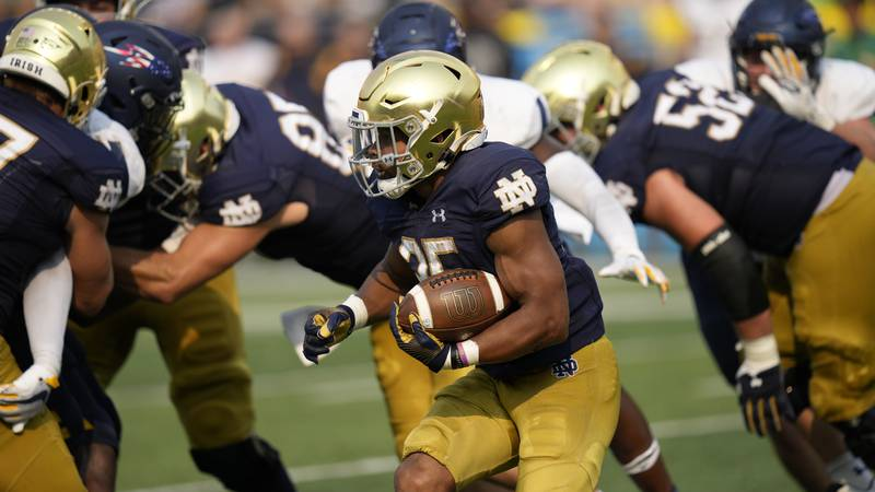Notre Dame running back Chris Tyree (25) inaction against Toledo in an NCAA college football...
