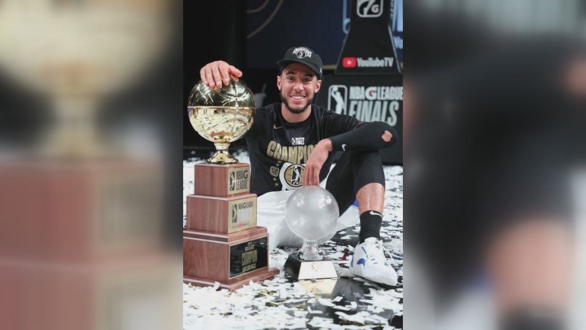 Cannady poses with G-League Finals MVP trophy.