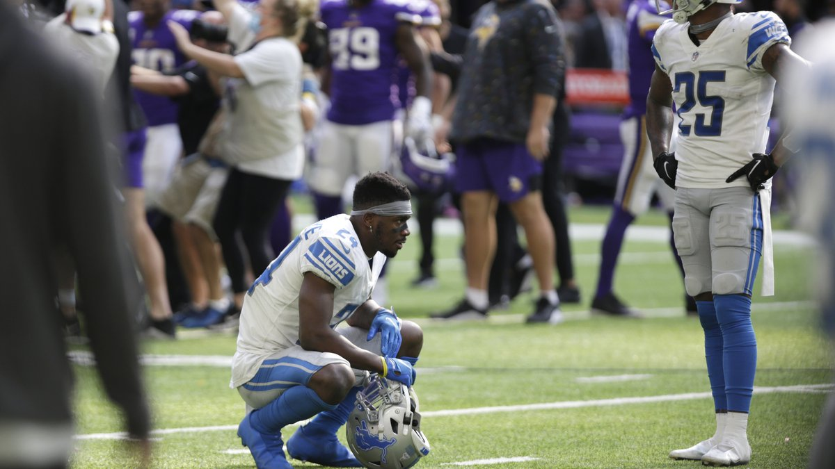 Detroit Lions cornerback Amani Oruwariye (24) and safety Will Harris (25) react at the end of...
