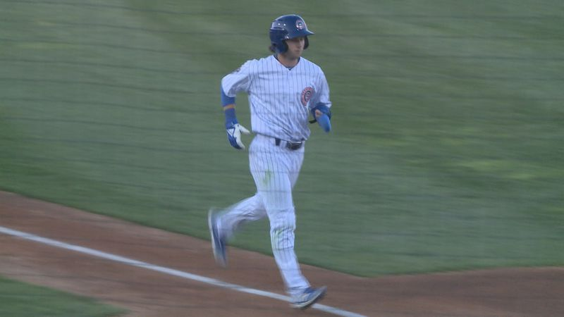 Cole Roederer scores after a walk in the third inning against Quad Cities.