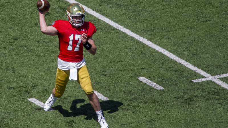 Notre Dame quarterback Jack Coan (17) throws during the Blue-Gold NCAA spring football game on...