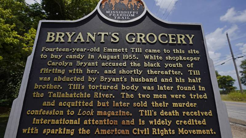 A Mississippi Freedom Trail marker sits before the remains of Bryant's Grocery and Meat Market...