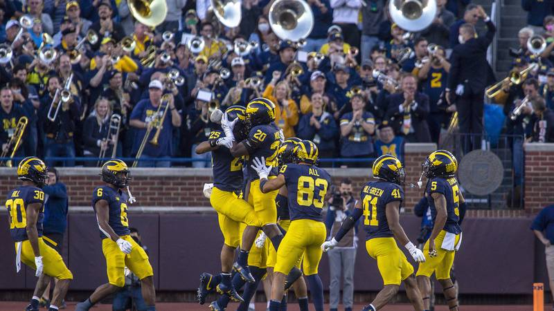Michigan linebacker Junior Colson (25) celebrates his recovery of a Rutgers fumble with...