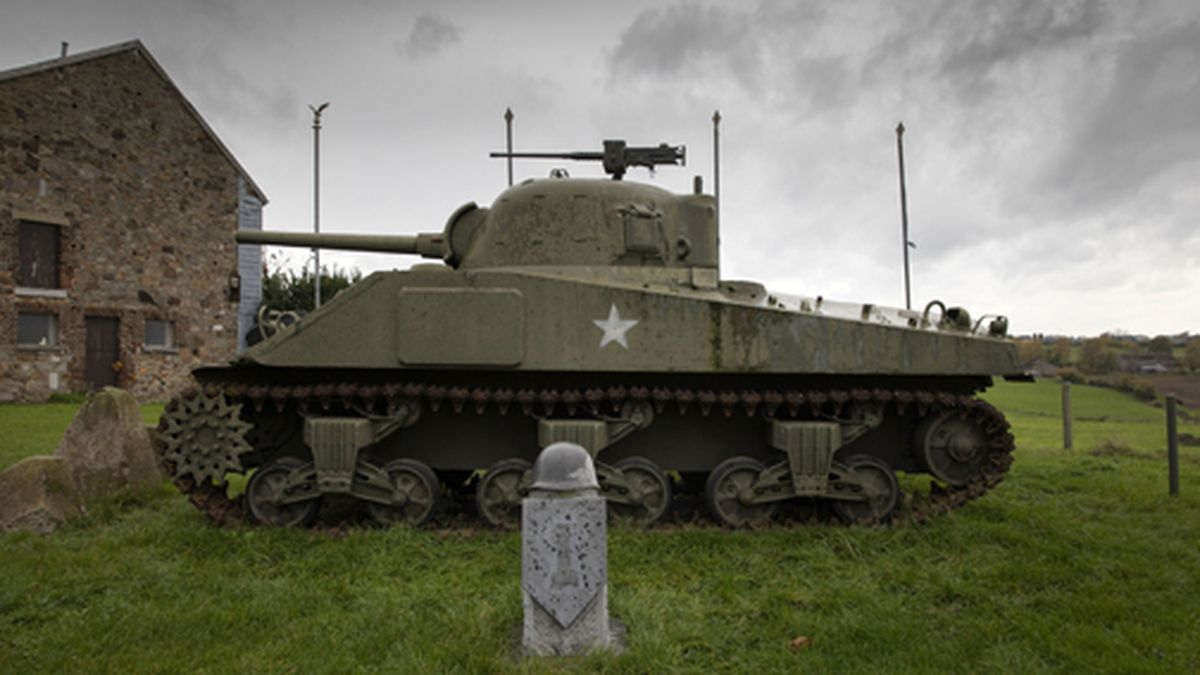 In this photo taken on Thursday, Nov. 7, 2019, A U.S. Army World War II Sherman tank sits on the hillside outside the Remember Museum 39-45 in Thimister-Clermont, Belgium. In the bucolic, verdant hills which were once among the worst killing grounds of WWII, Marcel and Mathilde Schmetz have shared coffee and cake with countless veterans, telling stories that span generations. Veterans of the WWII Battle of the Bulge are heading back to mark perhaps the greatest battle in U.S. military history, when 75 years ago Hitler launched a desperate attack deep through the front lines in Belgium and Luxembourg to be thwarted by U.S. forces. (AP Photo/Virginia Mayo)
