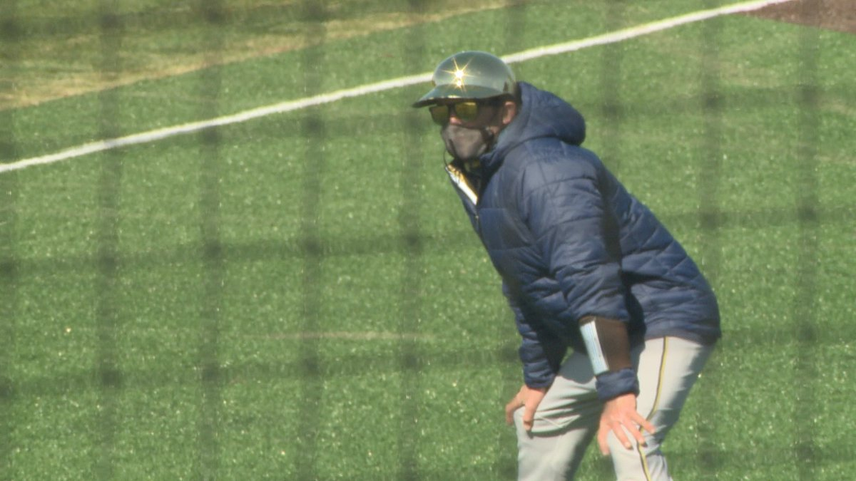 Scott Wingo coaches first base for Notre Dame during a road game against Valparaiso.