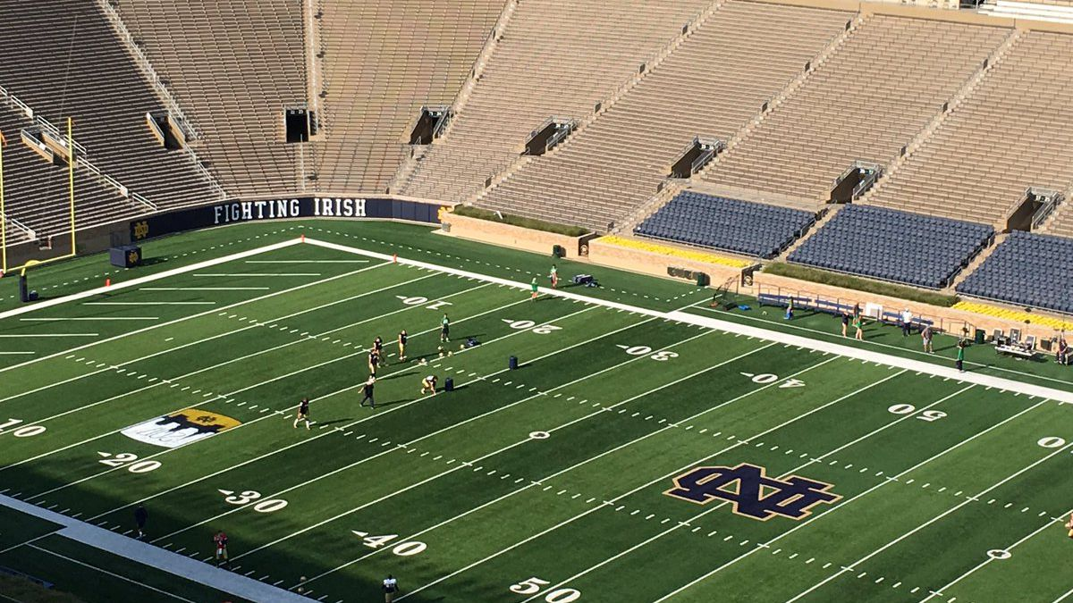 Notre Dame's football team practice on the field as the #NDtrail pilgrims make their way to...
