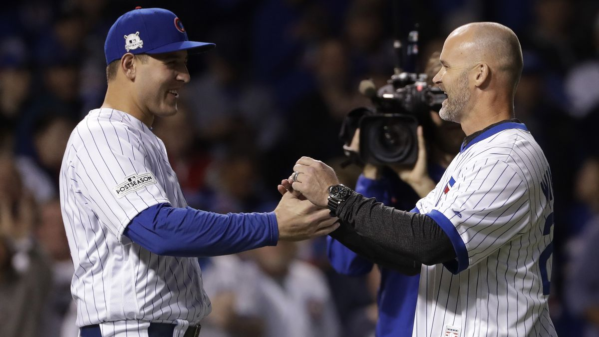 Chicago Cubs' Anthony Rizzo, left, greets David Ross after Ross threw a ceremonial first pitch before Game 5 of baseball's National League Championship Series between the Cubs and the Los Angeles Dodgers, Thursday, Oct. 19, 2017, in Chicago. before Game 5 of baseball's National League Championship Series, Thursday, Oct. 19, 2017, in Chicago. (AP Photo/Matt Slocum)