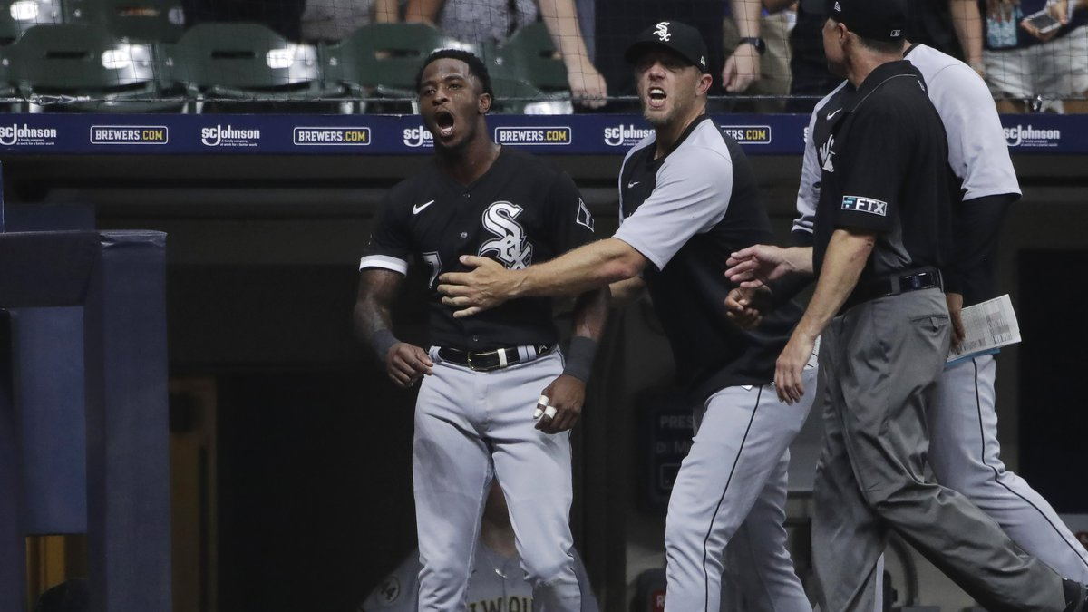 Chicago White Sox's Tim Anderson is held back by teammates as he yells at an umpire during the...