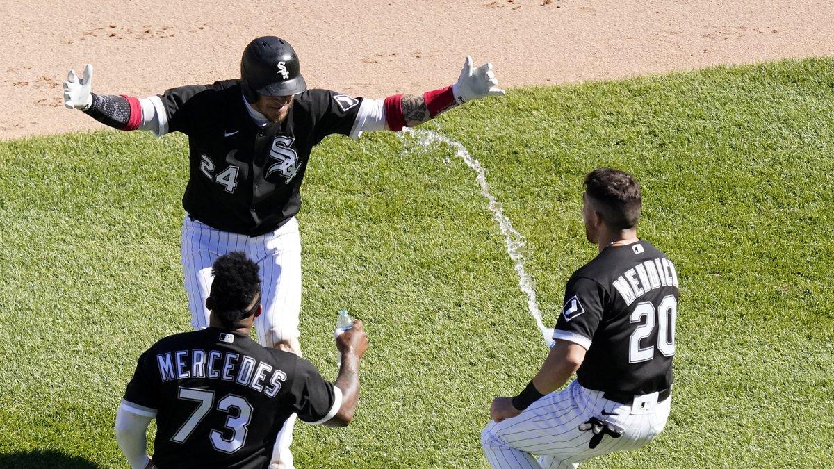 Chicago White Sox's Yasmani Grandal, center, celebrates his game winning single with Yermin...