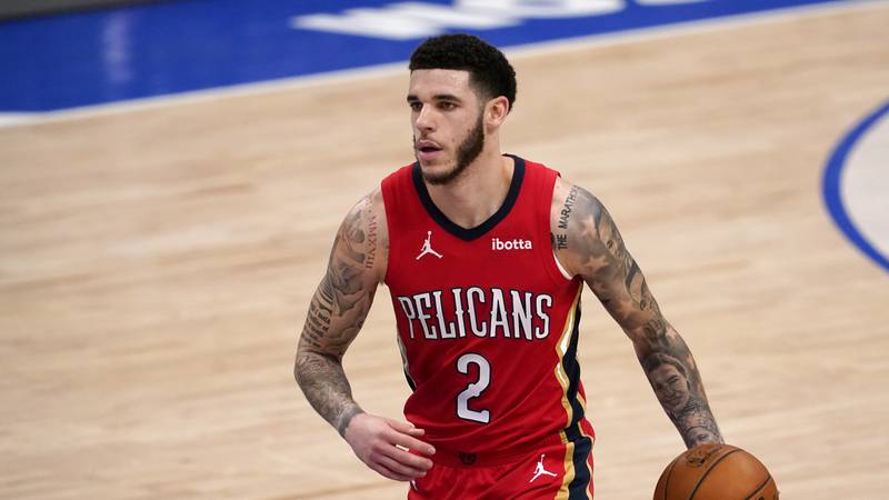 FILE - In this Feb. 12, 2021, file photo, New Orleans Pelicans' Lonzo Ball brings the ball up...