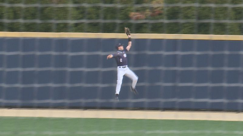 Irish outfielder Spencer Myers makes a leaping catch at the wall against NC State.