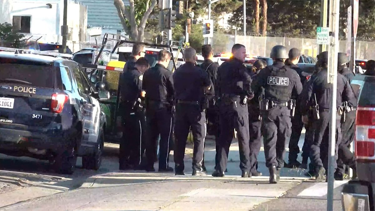 Officers respond to a shooting at a San Jose light rail railyard on Wednesday. Multiple deaths...