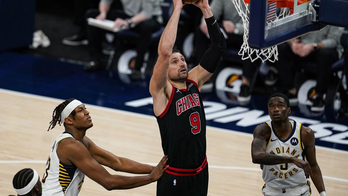 Chicago Bulls center Nikola Vucevic (9) gets a dunk over Indiana Pacers guard Edmond Sumner (5)...