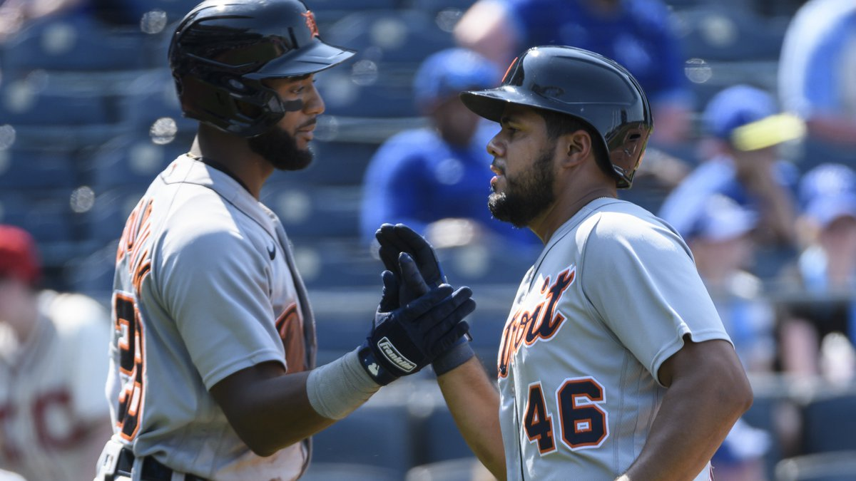 The Detroit Tigers' Jeimer Candelario, right, is congratulated by teammate Niko Goodrum, left,...