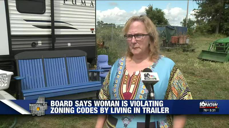 A woman's house burns down, forcing her to live out of a trailer on her property. But now,...
