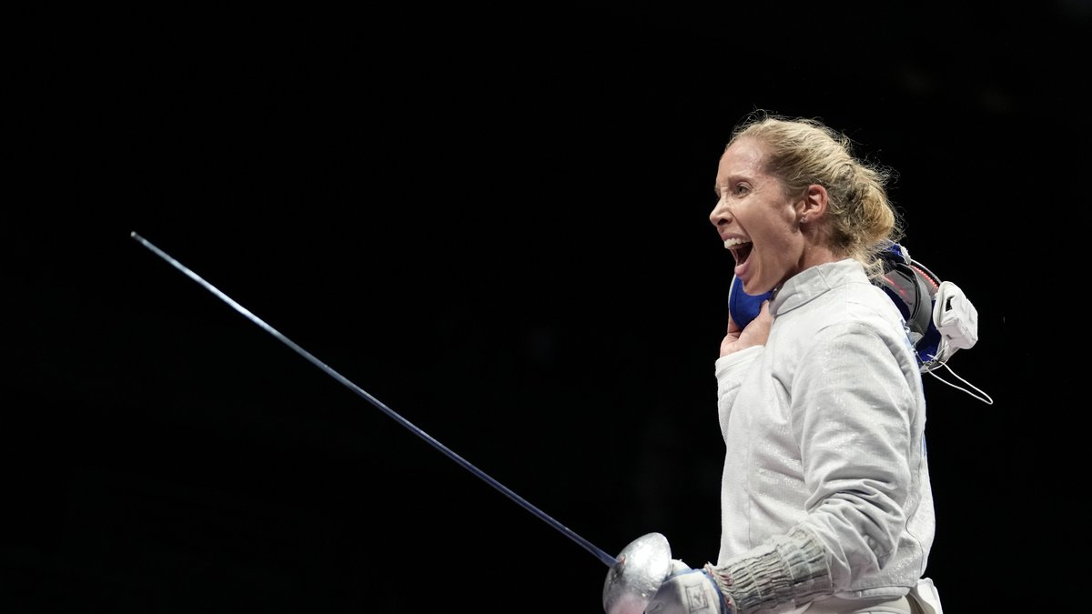 Mariel Zagunis of the United States celebrates after defeating Kim Jiyeon of South Korea in the...