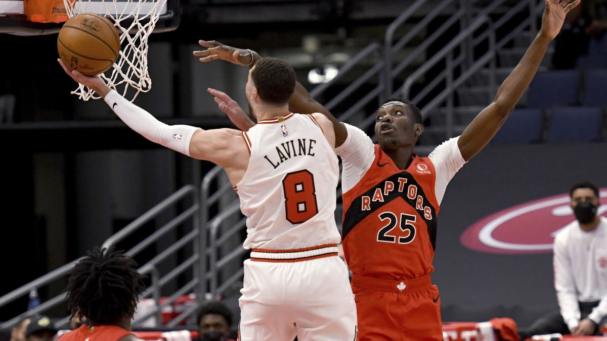 Chicago Bulls guard Zach LaVine (8) shoots against Toronto Raptors forward Chris Boucher (25)...