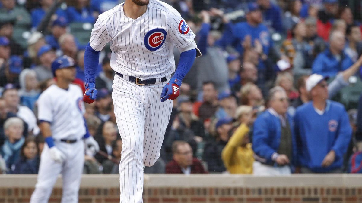 Chicago Cubs' Kris Bryant watches his solo home run hit off of St. Louis Cardinals' Adam...