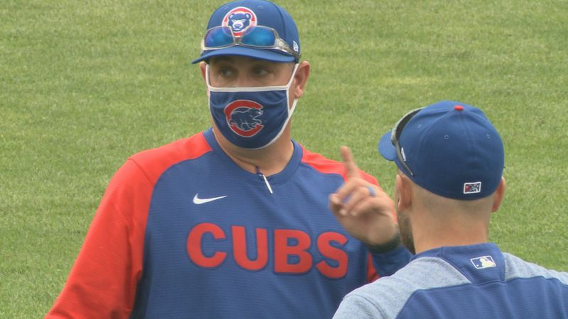 South Bend Cubs manager Michael Ryan talks with a Cubs player in a warmup on May 3, 2021.