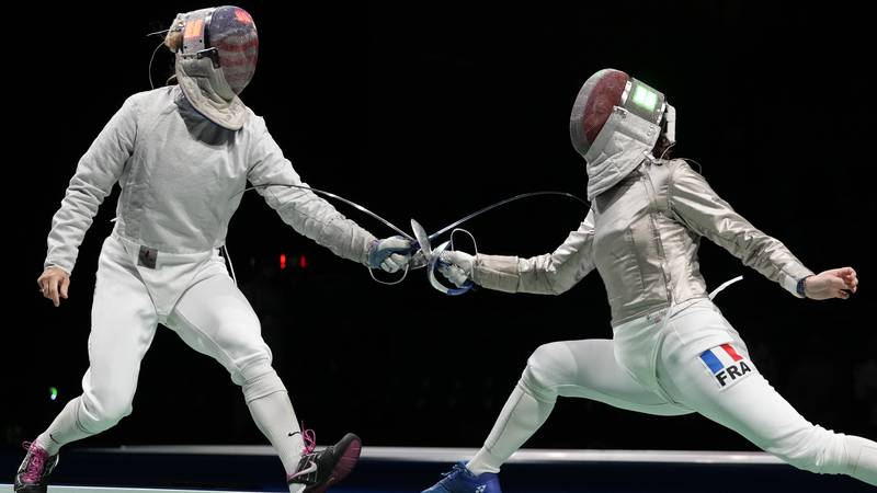 Mariel Zagunis of the United States, left, and Cecilia Berder of France compete in the women's...