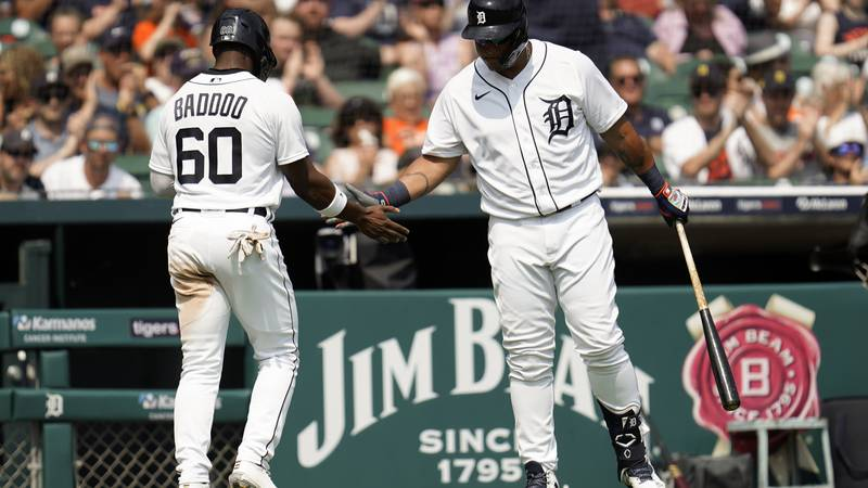 Detroit Tigers' Akil Baddoo (60) celebrates scoring with Miguel Cabrera on a Jonathan Schoop...