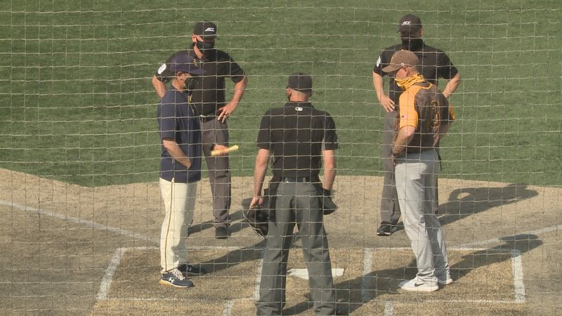 Notre Dame manager Link Jarrett exchanges lineups with Valpo before a game on April 27, 2021.