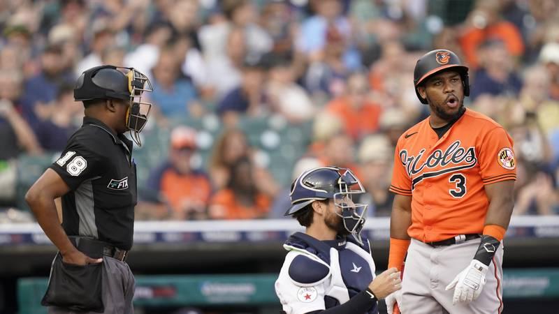 Baltimore Orioles' Maikel Franco shows his displeasure of a call strike by umpire Ramon De...