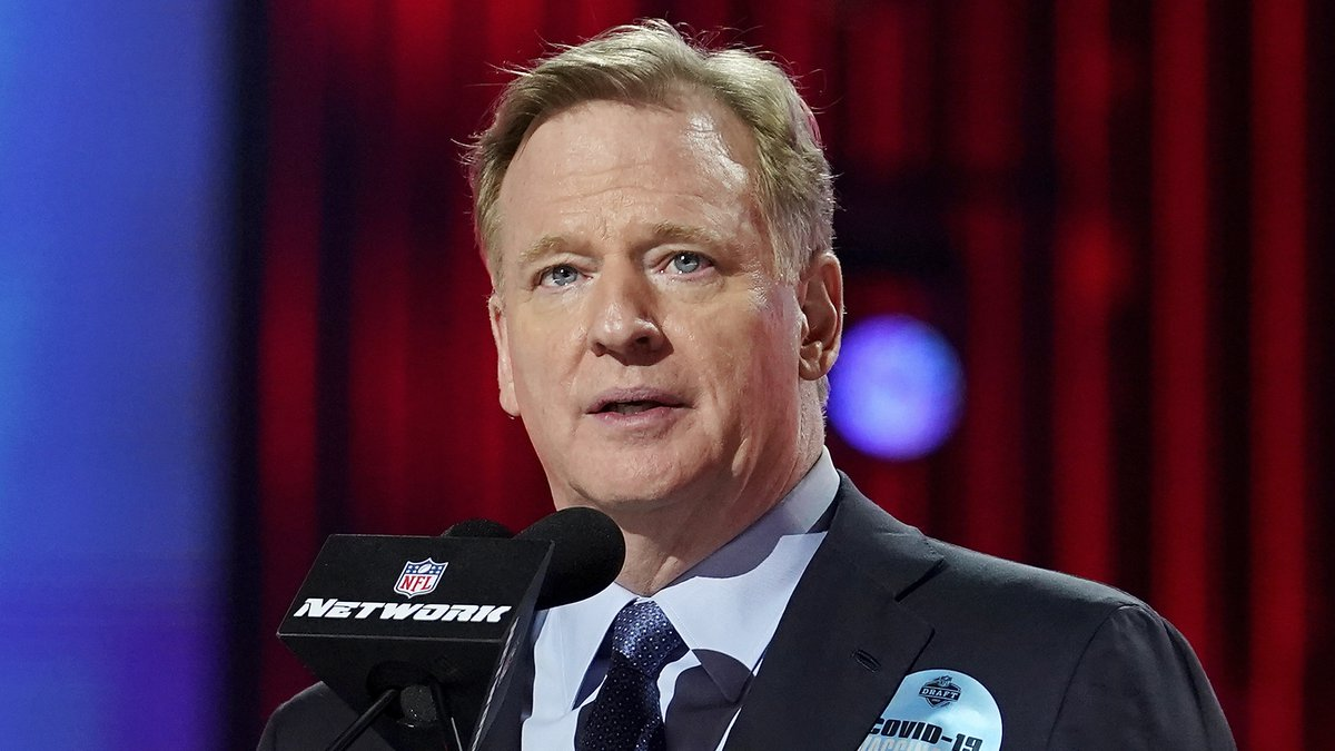 FILE - In this April 29, 2021, file photo, NFL commissioner Roger Goodell, wearing a COVID-19...