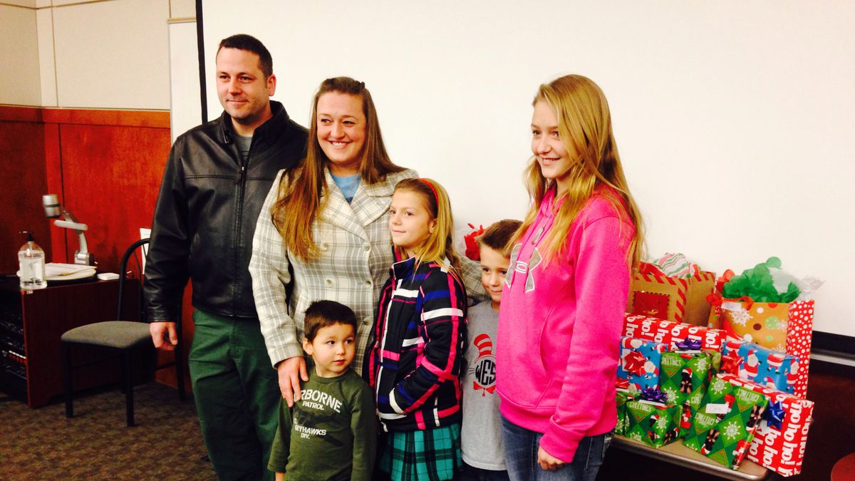 Brandon and April Martin, along with their four kids were surprised with several wrapped gifts...