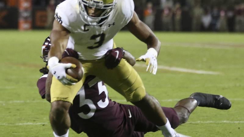 Notre Dame wide receiver Avery Davis (3) scores a touchdown past the defense of Virginia Tech...