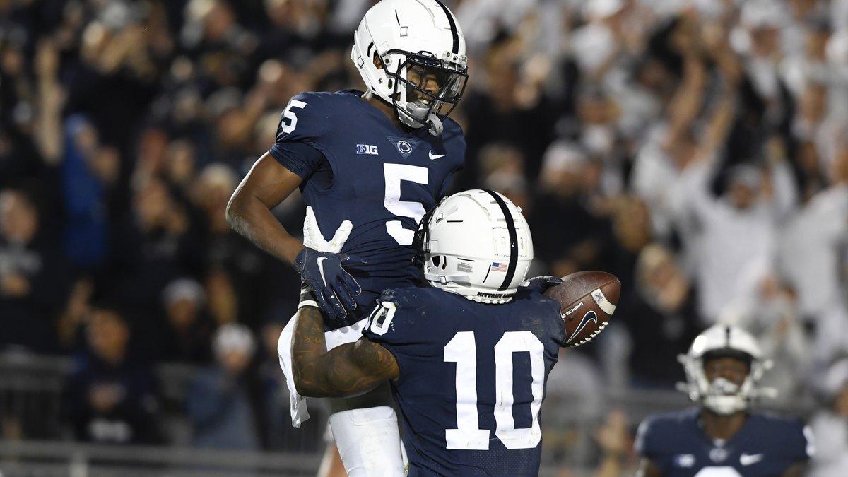 Penn State wide receiver Jahan Dotson (5) celebrates a third quarter touchdown pass with John...