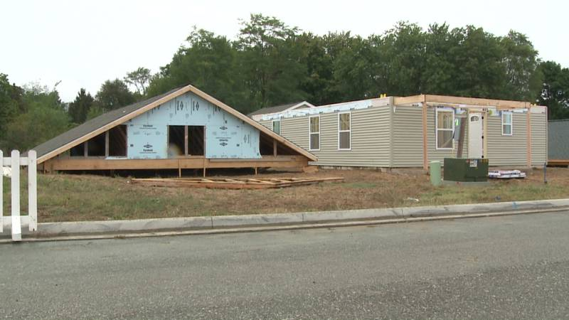 About 150 volunteers a day have been working there all week to build another half dozen homes.